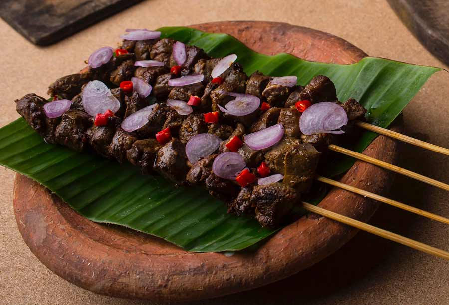 Beef Sheek kebab are served over a banana leaf.