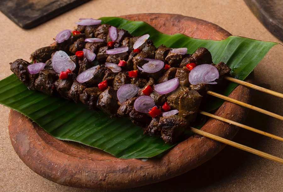 Beef Sheek kebab are served over a banana leaf.