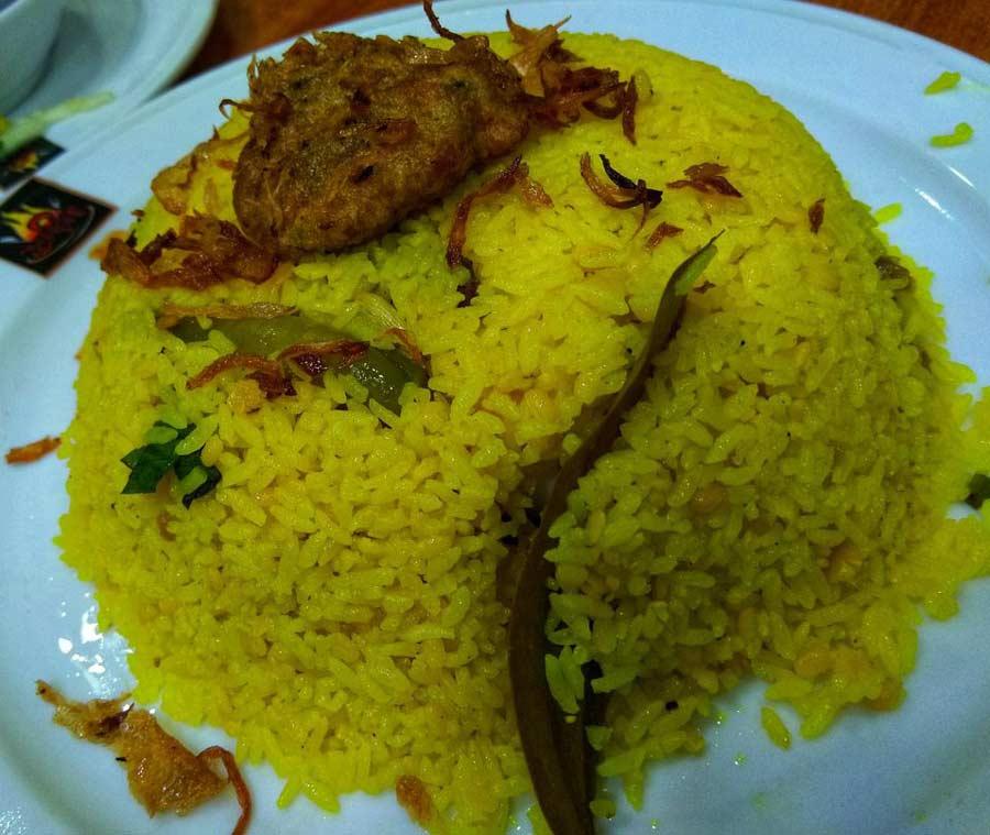 Decorated bhuna khichuri over a plate.