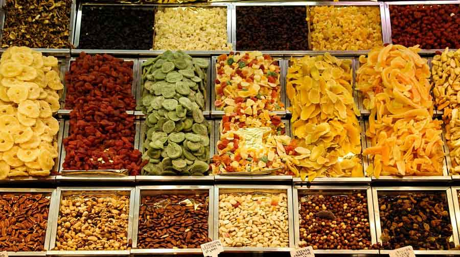 Various dried fruit decorated separately on shop. Those dried fruit can provide you huge calories.