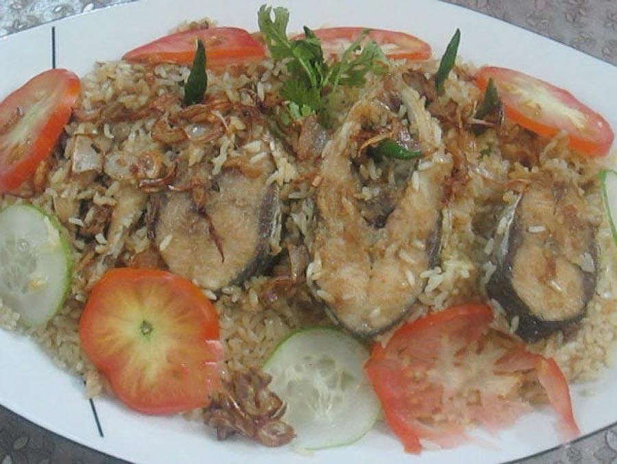 Hilsha fish polao over a plate