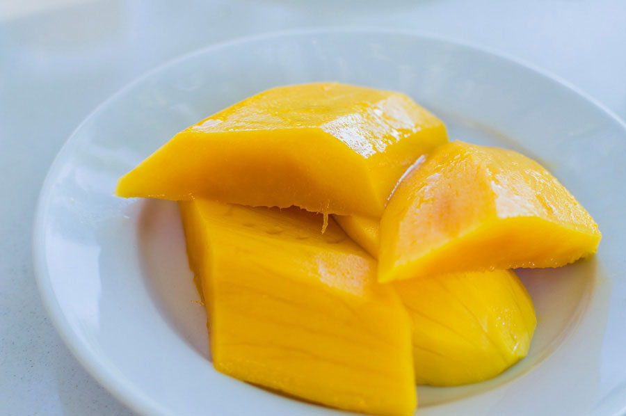 Juicy mango sliced on a plate.