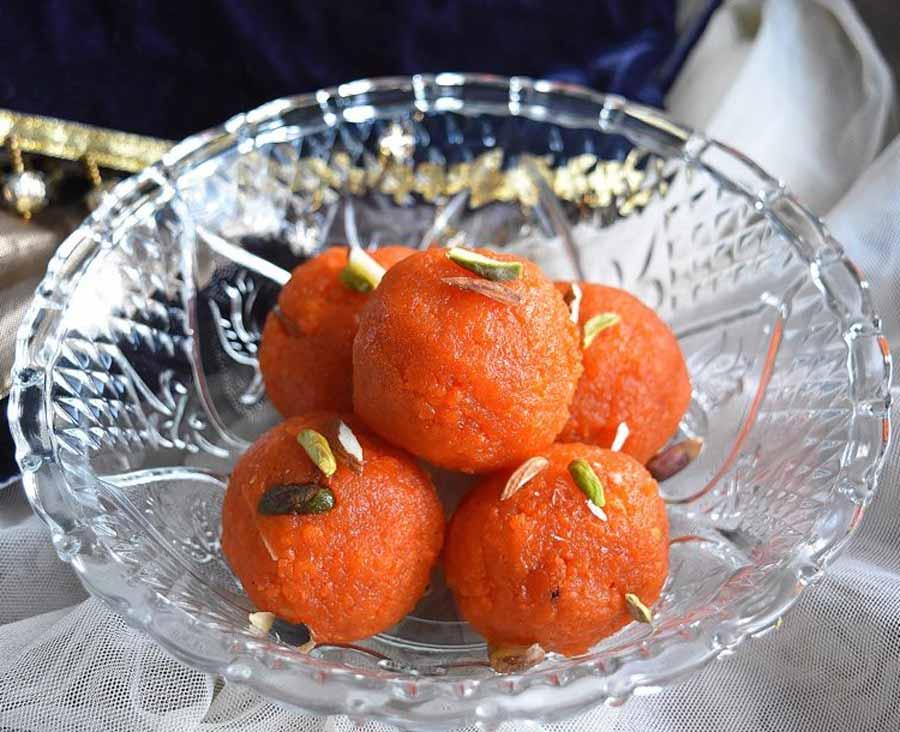 Motichur laddu on served over a bowl.