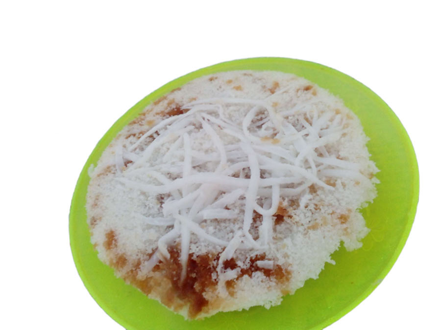 Vapa pitha over a plastic plate.This are mostly available most of the season.